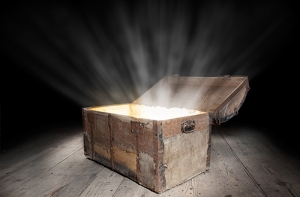 wooden treasure chest with the strong glow from inside